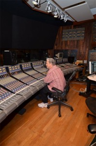 The producer sits at the console in Studio A control room.