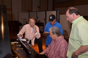 Brian works out a part at the piano with (L-R) Al, Bruce, and Jeffrey.  Photo by David Goggin.